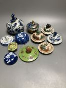 Eleven Chinese or Japanese porcelain or cloisonne enamel covers, tallest 11cm
