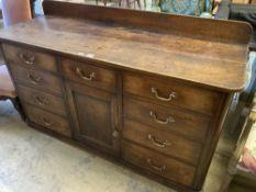 A late George III mahogany low dresser, fitted nine small drawers, about a central cupboard, width