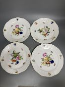 A set of four Herend Meissen style floral painted dessert dishes, diameter 25.5cm