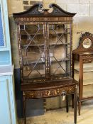 An Edwardian marquetry inlaid mahogany bow front display cabinet, width 92cm, depth 47cm, height