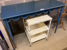 A Regency style cream painted three tier bedside table, a blue painted white lined dressing table (