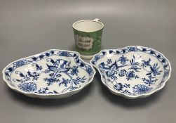 Two Meissen onion pattern shell-shaped dishes, width 19cm, and an English porcelain cabinet cup,