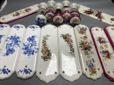 Five pairs of French porcelain door handles and ten porcelain door plates