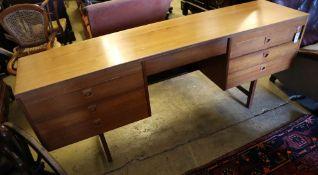 An Alfred Cox teak sideboard, Danish design, width 183cm, depth 43cm, height 72cm