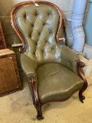 A Victorian carved and moulded showood frame spoonback armchair on scrolled legs, upholstered in