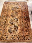 An Afghan rust ground rug, 207 x 131cm
