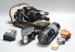 A Minolta 9000 SRL camera, a Minolta 75-300 zoom lens, with flash, together with a Sanwa Mycro