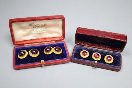 A pair of Victorian gold and red cabochon cufflinks, gross 8.4 grams, and a matching set of three