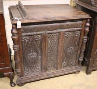 An 18th century and later carved oak side cabinet, width 83cm, depth 52cm, height 82cm