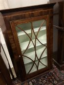 A George III mahogany hanging corner cupboard with glazed door, width 74cm, depth 39cm, height