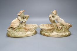 A pair of Worcester James Hadley blush ivory figural dishes, height 15cmCONDITION: Male - his hat