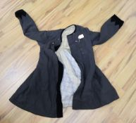 A 19th century Russian linen velvet edged coat with padded lining