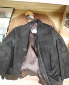 A light tan 1960's suede jacket and a similar chocolate brown jacket