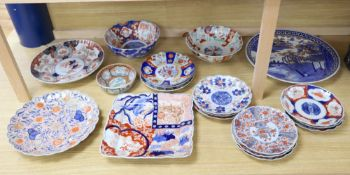 A collection of Japanese Imari dishes, bowls and a large square dishCONDITION: One large Imari