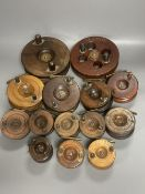 A collection of mahogany and brass fishing reels, largest 17.5cm (14)