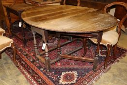 An early 18th century oak gateleg dining table, width 144cm extended, height 70cm