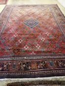 A Hamadan red ground carpet, 422 x 307cm