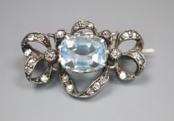 An Edwardian white metal, aquamarine and diamond set scroll brooch, 25mm, gross 3.8 grams.CONDITION: