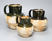 A graduated set of three Victorian Royal Doulton earthenware harvest jugs, tallest 19cm
