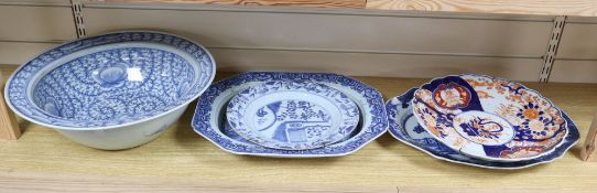 A Chinese blue and white bowl, three Chinese blue and white plates and an Imari plate, largest