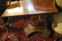 A Victorian mahogany adjustable reading table, the top fitted two adjustable sections, width 82cm,