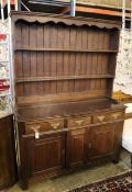 A George III style oak dresser, width 138cm, depth 45cm, height 190cm
