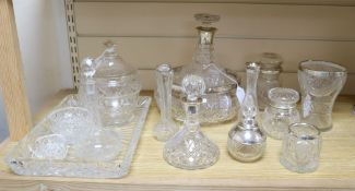 A collection of silver-mounted and other cut glass items, the silver-mounted items comprising an