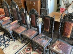 A set of six 19th century Flemish carved oak dining chairs, two with arms (fault)