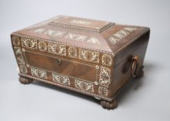 A Victorian mother of pearl-inlaid rosewood sarcophagus work box, width 31cm height 18cm