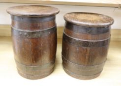 Two coopered oak sherry barrels (converted as small tables), height 39cm