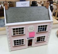 A modern doll's house 'Glen Tay Cottage', with interior furnishings, height 63cm