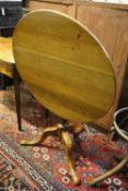 A George III oak circular tilt-top occasional table, diameter 80cm, height 74cm