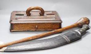 A kukri, an oak inkstand and a tribal throwing club