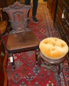 A Victorian carved mahogany hall chair and a Victorian carved rosewood adjustable music stool (2)