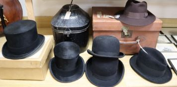 A solar pith helmet in japanned metal case, a military cap, a leather dressing case and seven