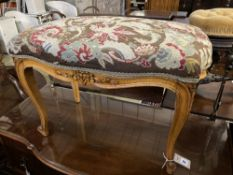 A Louis XVI style walnut dressing stool with tapestry seat, width 76cm, depth 46cm, height 50cm