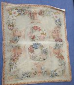 An Antique French needlepoint panel, decorated with a continuous band of flowers and two central