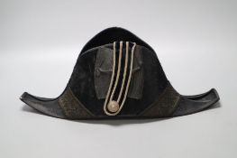 A WWI bicorn naval hat with Kings crown button