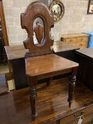 A Victorian mahogany hall chair