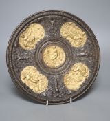 A bronzed metal plaque, diameter 28cm