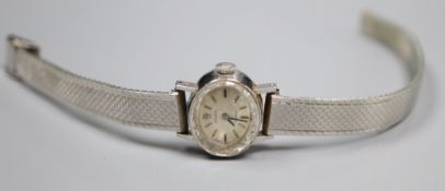 A lady's 18ct gold Rolex precision manual wind oval wrist watch, on a rhodium bracelet, overall