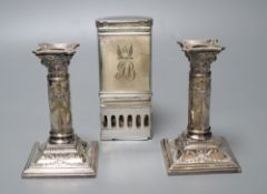 A pair of Victorian plated and embossed dwarf candlesticks and a Victorian plated pocket lamp,