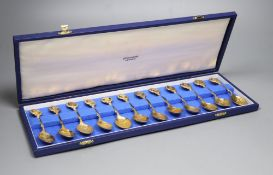 A set of 'The Twelve Roman' silver gilt spoons, sculpted by David Cornell, one of a limited