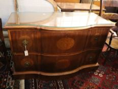 An inlaid walnut chest of shaped form, fitted two long drawers on plinth base, width 124cm, depth