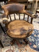 A Victorian leather upholstered mahogany swivel desk chair