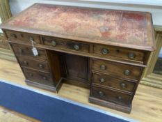 A Victorian mahogany kneehole writing desk, width 116cm depth 57cm height 77cm