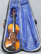 A violin labelled W Placht & Co, 58cm, cased
