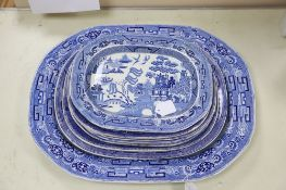 A 19th century transfer-printed large blue and white platter and seven similar smaller platters