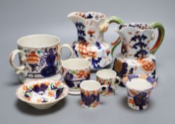 Eight pieces of Ironstone china including two jugs and a three handled cider mugCONDITION: One