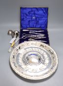 An Eastern embossed plated tray, a cased plated nut and grape set, a plated coffee pot, a silver
